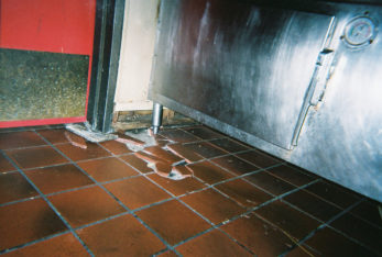 Damaged tile flooring